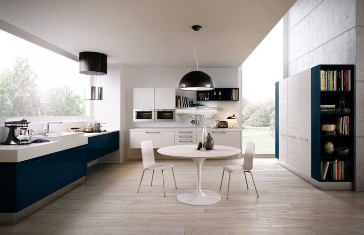 New York Modern Kitchen Design Ideas with blue kitchen cabinets and small round white dining table also wooden floor top fancy blue based kitchen