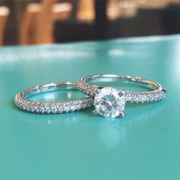 This stunning Brilliant Earth matched set dazzles with a four-prong set center diamond floating above three rows of gorgeous pavé set diamonds. The matching wedding band sits flush with the engagement ring.