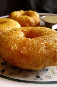 A vada is a South Indian snack staple made of a lentil or flour batter fried into a doughnut shape.