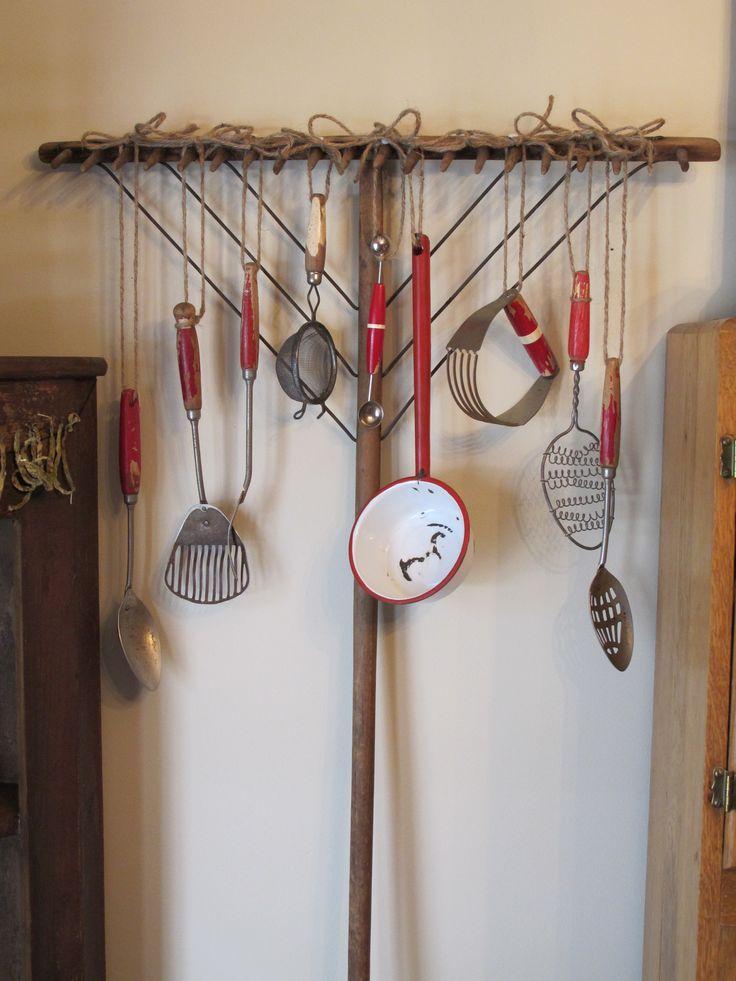 Vintage kitchen tools hung on a primitive rake