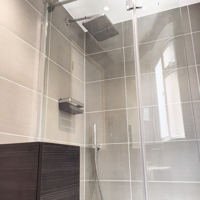 Imagine coming home from work to a hot #shower under this! Another great recent install from our team #bathroom #tiling #luxury #beautiful https://instagram.com/bathroomboutiqueltd/