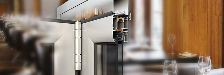 Porte a libro Alumil M19800 serie termicamente isolata per #porte #scorrevoli a libro con profondità dell'anta di 50 mm: #battenti silenziosi, possibilità di incorporare la guida nella pavimentazione e di utilizzare un #battente come porta d'entrata