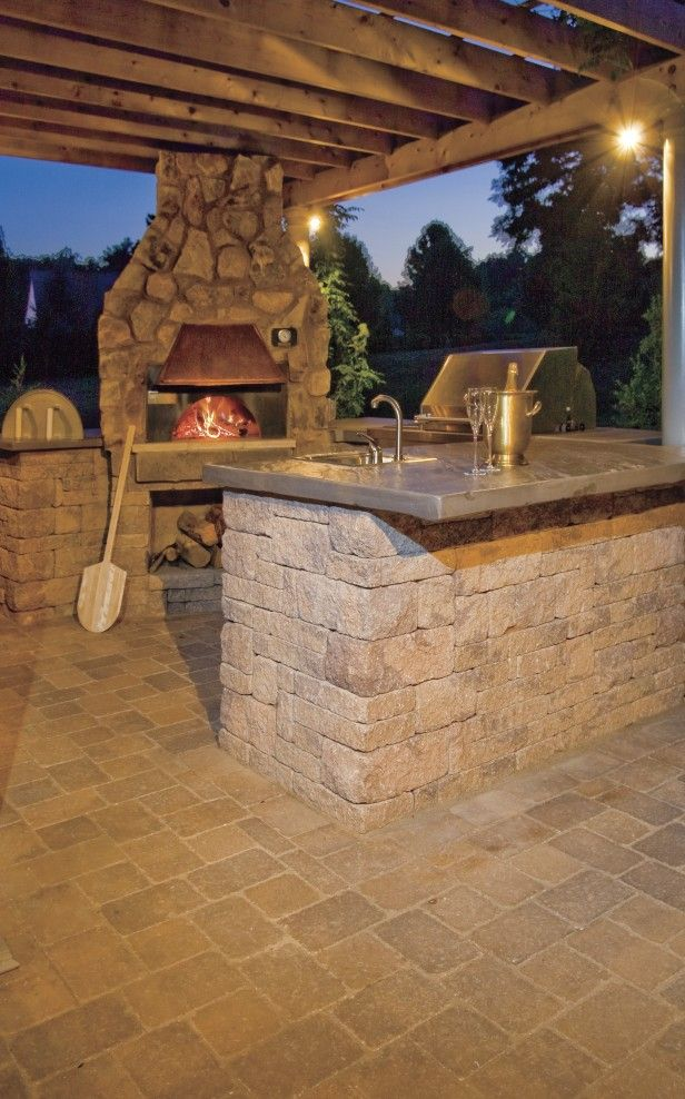 Bored with your indoor kitchen? Move it outside with a full service kitchen that includes a pizza oven, grill, sink and appliances.
