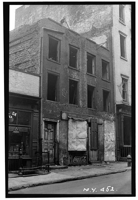 In 1936, the oldest known house in Manhattan, on the southern end of Cherry Street, was demolished as part of a citywide slum clearance campaign. The Dutch-style town house was constructed around 1760, and reportedly housed some of George Washington's officers during the Revolution.