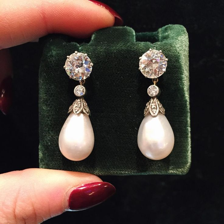 Pair of antique drop pearl and diamond pendant earrings, c.1900