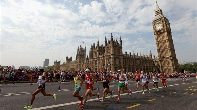 Athletes run past Big Ben as they compete in the Men's Marathon