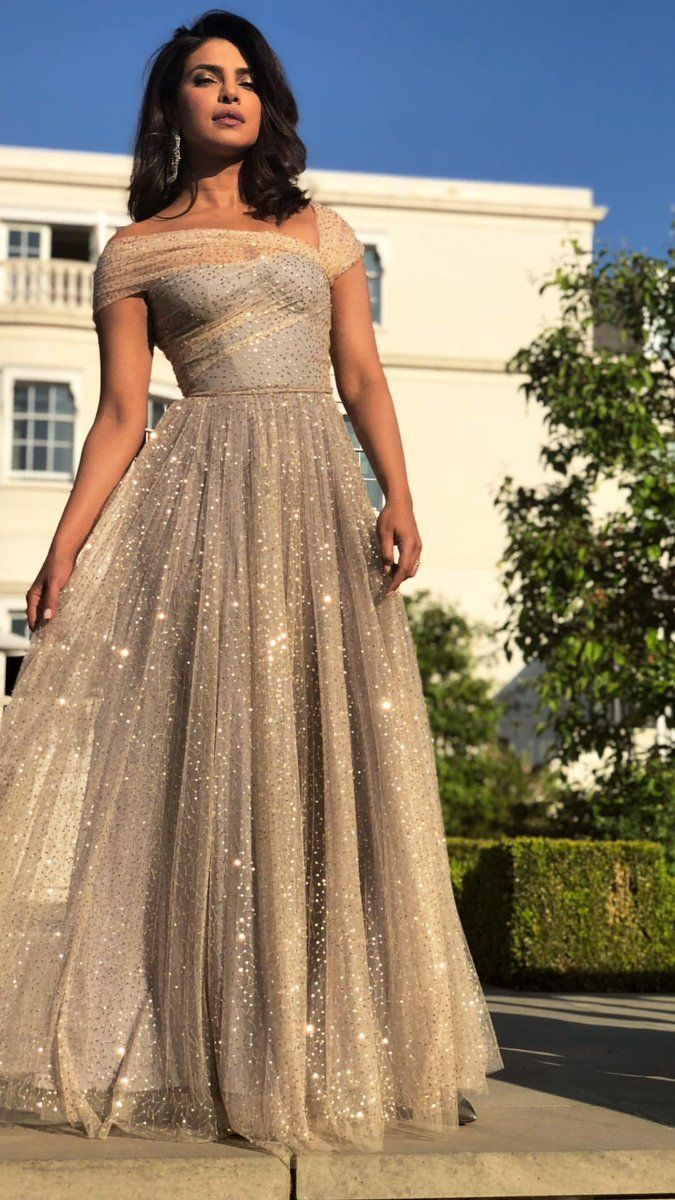 fec7d6f9478d Priyanka Chopra in Christian Dior attends the wedding reception of Prince  Harry and Meghan Markle in London.  bestdressed