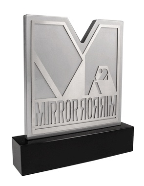 Mirror Mirror Urban Community Recognition Awards: Bennett Awards designed these custom awards for the Mirror Mirror Awards, which are recognition awards that honor urban community icons, luminaries, and trendsetters in a variety of industries, including entertainment, fashion and beauty. These awards are created from laser-cut metals - both aluminum and stainless steel - that are layered to create and reveal the Mirror Mirror logo.