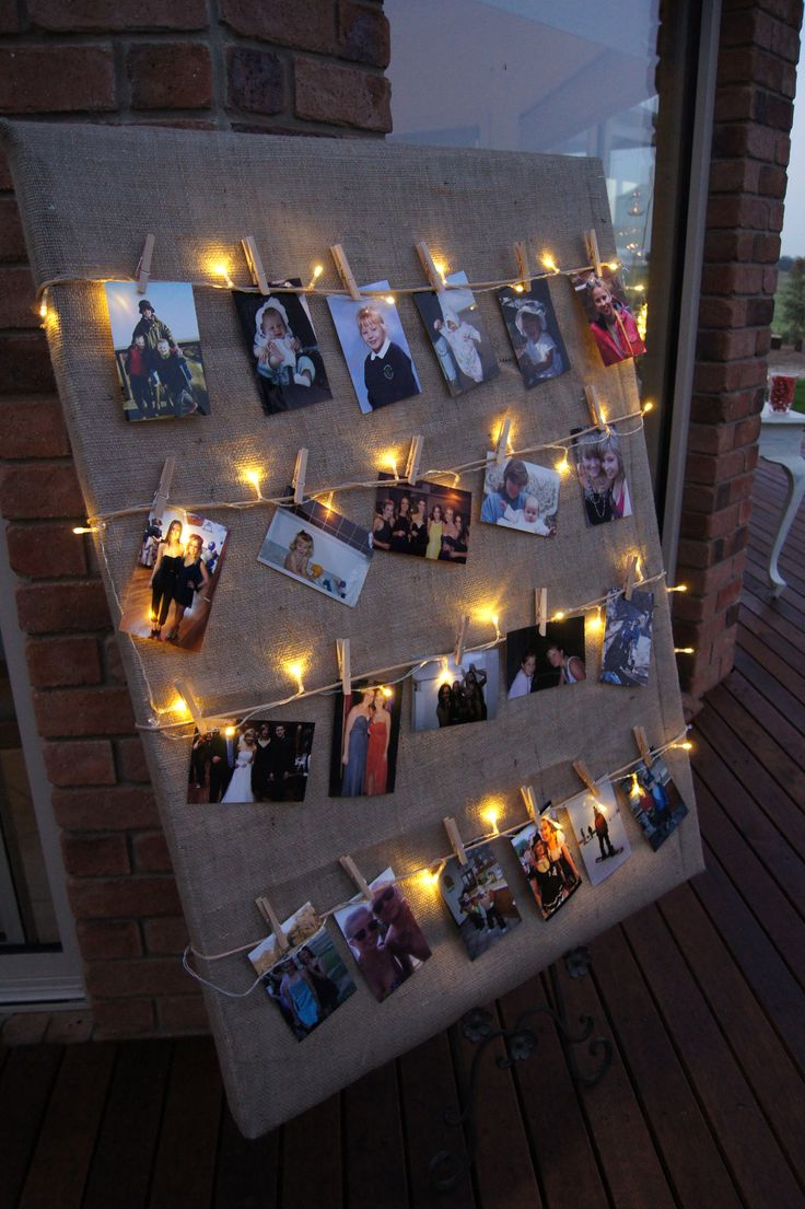 DIY photoboard with a canvas covered and string with lights on                                                                                                                                                      More