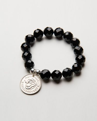 FACETED ONYX COIN BRACELET $46.00 These stunning black onyx stones are faceted and polished beads reflecting the light with a beautiful sparkle. The bracelet also features two round sterling silver beads and a single Australian Shilling . A timeless, classic piece guaranteed to accent any outfit beautifully. Match them with a stunning set of our Faceted Onyx Drop earrings.
