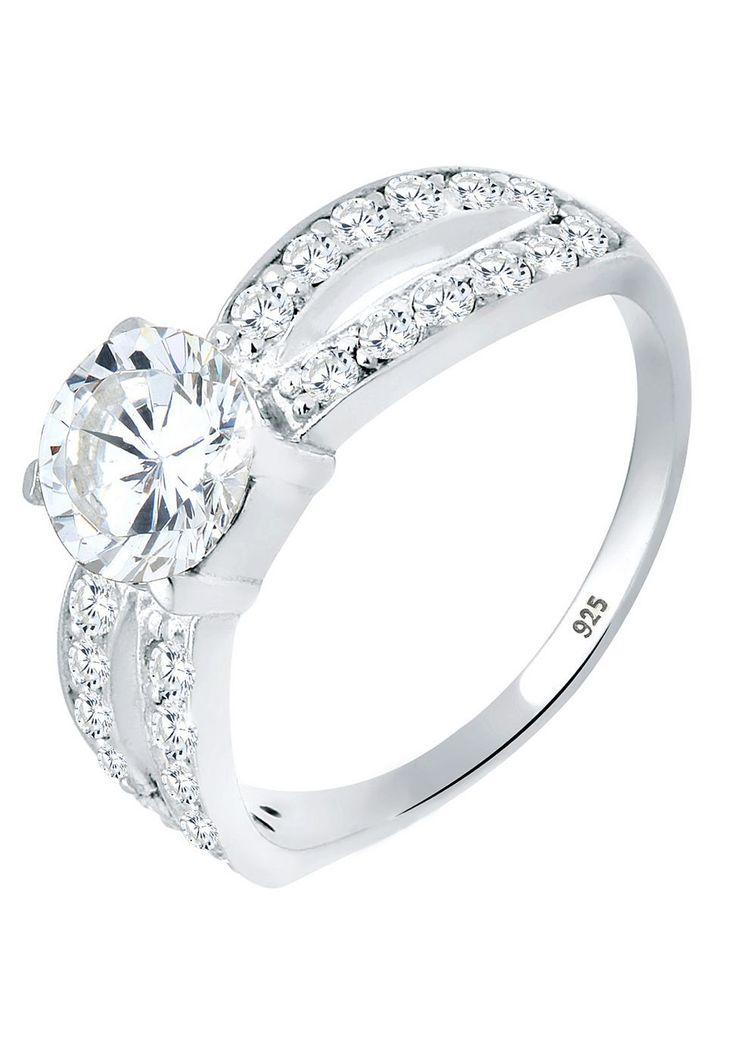 """Traumhaft funkelnder Ring aus feinem 925er Sterlingsilber mit einem in Krappenfassung eingefasstem Zirkonia in Weiß. Zweigeteilte Ringschiene besetzt mit 26 kleinen Kristallen in Weiß.  Weitere Hilfe zur Ringgröße:  Angegebene Größe in mm entspricht """"Ring Innen-Umfang"""", Umrechnung in """"Ring Durchmesser Ø"""" wie folgt:  52mm Umfang = 16,5mm Ø 54mm Umfang = 17,2mm Ø 56mm Umfang = 17,8mm Ø 58mm Umfan..."""