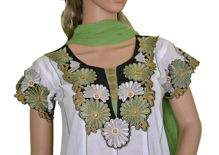 Anarkali style White  Cotton Kameez accompanied with Pistachio Green Chudidar and Dupatta. The Kameez has with Green Embroidery patch on the neck, sleeves and bottom. Match it with Pistachio green & gold/silver jewellery for Casual wear. Buy it on www.folklor.in