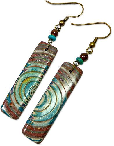 Sherri Kellberg's earring's made from polymer clay extrusions featured on PCD