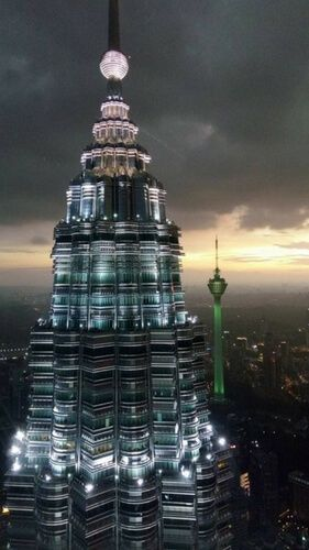 One of the Petronas Twin Towers with KL tower in background in Kuala Lumpur