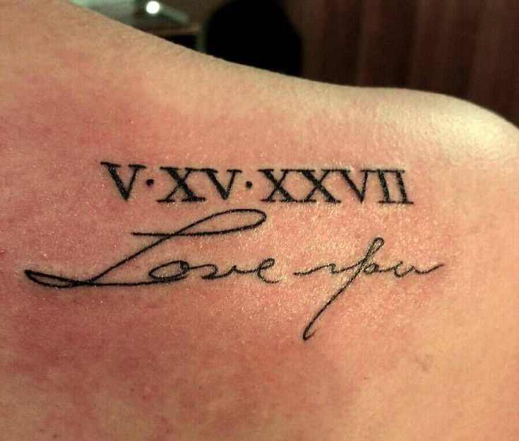 Small shoulder blade tattoo done in memory of Cassidy's Grandma who passed away last year. She got her birthday in roman numerals 5/15/27. Under it, she got in Grandma's handwriting from a card she...