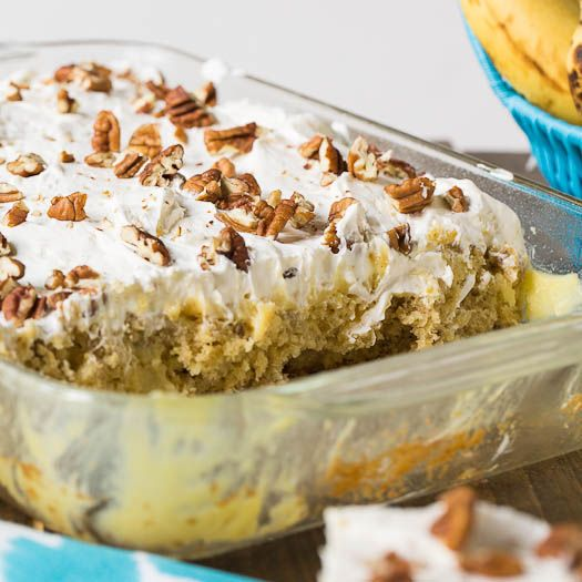 An easy and fun poke cake with the flavors of a southern Hummingbird Cake. Banana, pineapple, cinnamon, and pecans give this moist cake loads of flavor.