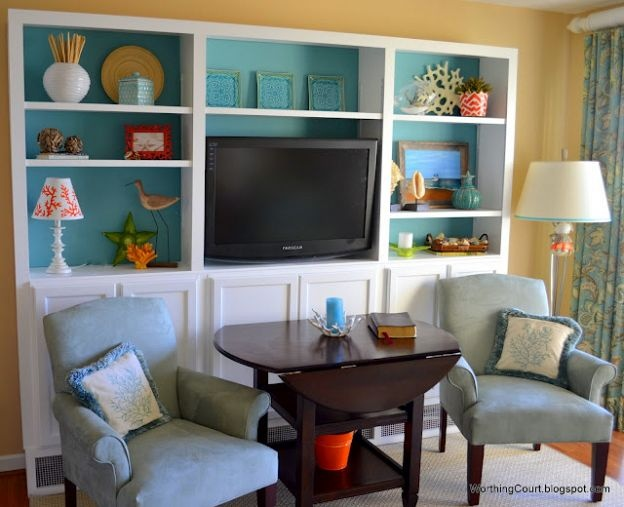 DIY Bookcases Using Kitchen Cabinets as the Base and I like these chairs