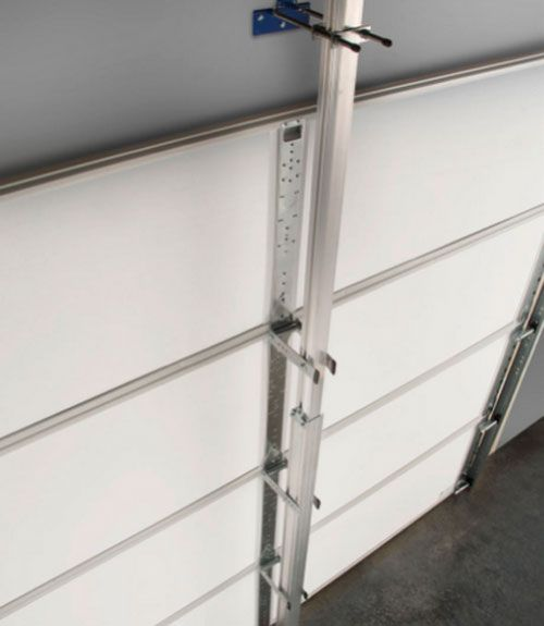 The Tech: Secure Door offers a vertical bracing system made of aircraft-grade aluminum that serves as a rigid backbone for the garage door. It anchors into the wall above the door, into the floor and into each hinge, preventing the door from blowing in or suctioning out.