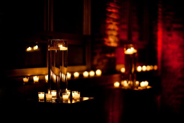 gorgeous candle decor with brick background. insanely lovely.