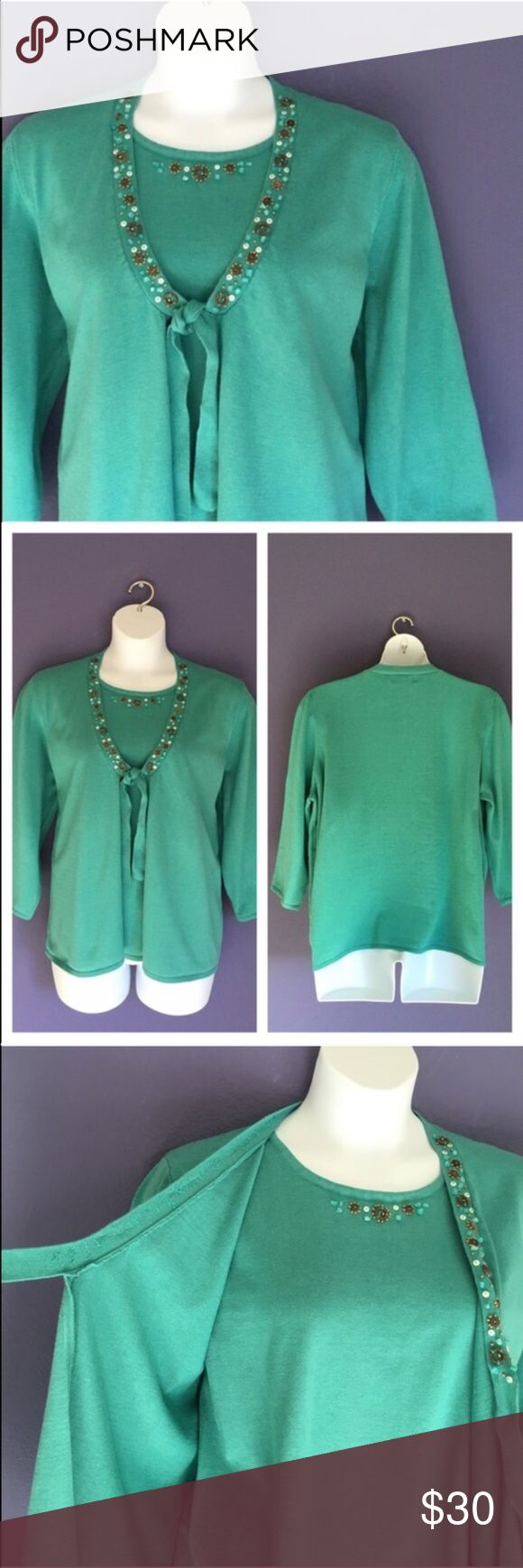 "Alfred Dunner Embellished Sweater This sweater looks like 2 pieces, but is actually one piece (see picture # 3). The embellishments add pop to the gorgeous seafoam green color.   Perfect for any occasion.  Pair with jeans for a more casual look. Material:  55% Cotton/45% Acrylic. Measurements:  Length - 27""/Bust - 26""/Waist - 26"" Alfred Dunner Sweaters"