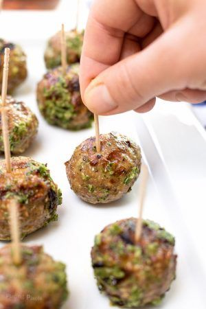 Easy authentic Greek Turkey Meatballs with Cucumber Mint Sauce. Juicy grilled turkey meatballs paired with homemade tzatziki. A healthy and flavorful appetizer that will wow your guests this summer. Clean eating with gluten free option - www.platingpixels.com