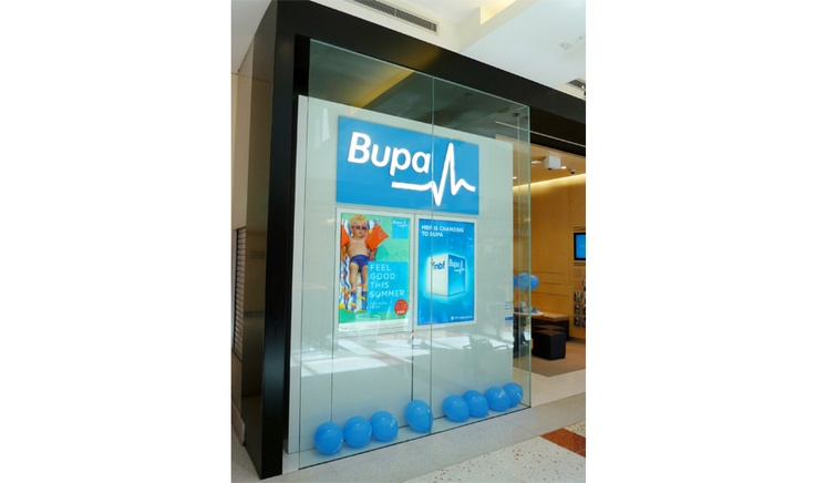 National Rebranding BUPA Corporate signage including illuminated shopfront signage using gel resin lettering by Singleton Moore Signs www.smsco.com.au