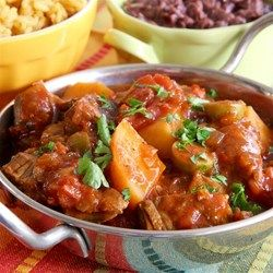 Slow Cooker Spanish Beef Stew - Allrecipes.com  I have never heard a complaint of my beef stew, it's a great new take on an old favorite! I prefer to serve stew over white rice, it all depends on your taste. You can season the beef with a packet of Sazon instead of salt and pepper, for even more Spanish style