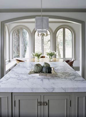 white marble counter tops on gray cabinets.