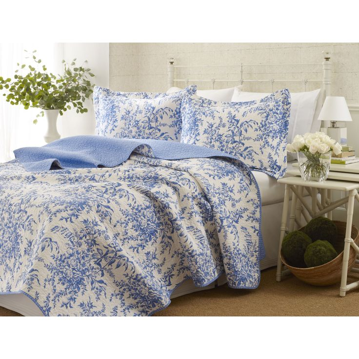 prewashed for extra softness this quilt set is adorned with a vibrant blue floral pattern