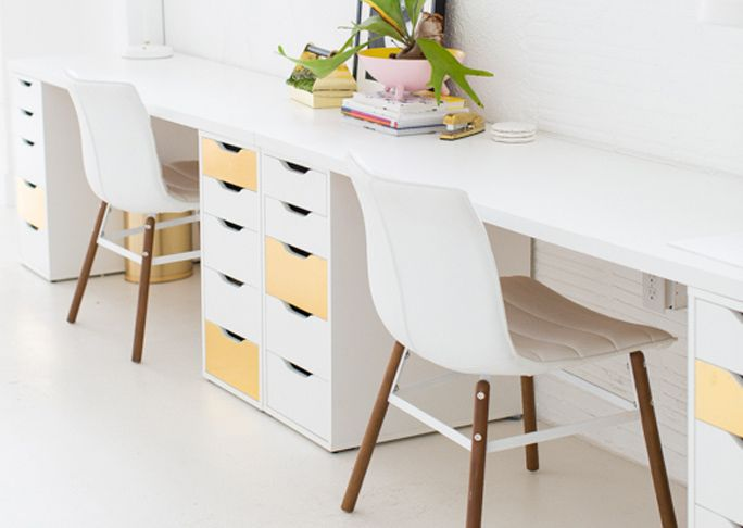Table top with plenty of storage creates two great workspaces.