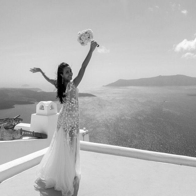 happy beautiful bride white bridal bouquet Santorini wedding lace wedding dress caldera view