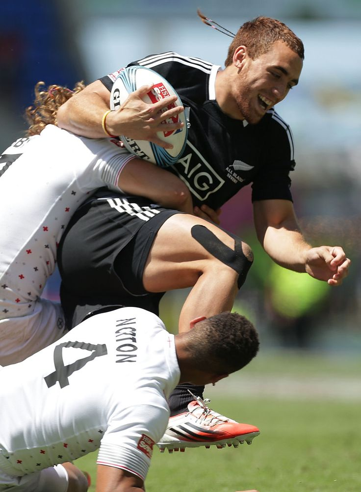 Joe Webber of New Zealand is tackled by Dan Norton and Dan Bibby of England