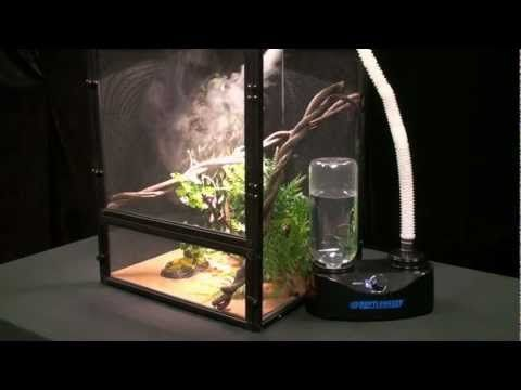 """Increase your tanks humidity with Zoo Meds new Reptile Fogger™, a Compact Ultrasonic Humidifying Reptile Fogger with adjustable fog output control. This unit comes ready to operate! It includes a one liter bottle and all the necessary fittings. It also features a """"no-spill"""" valve making it easy to remove and refill the water bottle."""
