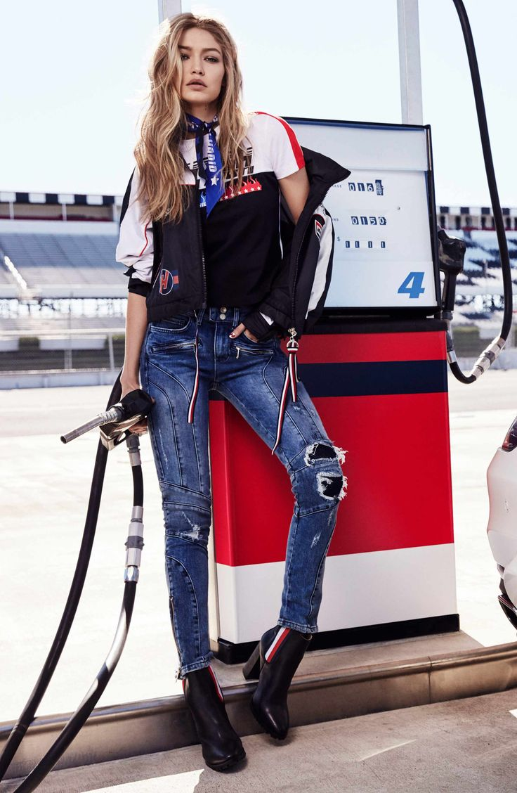 "Moto-inspired stitching and edgy zip detailing define skinny, ankle-zip jeans strategically distressed and ripped at the knees for a ""been there, rode that"" look."