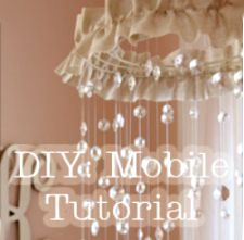 Homemade baby crib mobile decorated with keepsakes from mom and dad's wedding