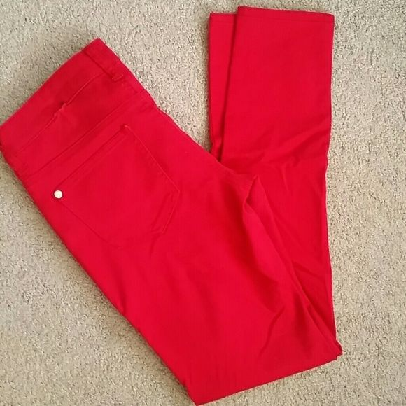 Just dropped! Red skinny pants Red skinny pants. Small tear at seam shown in 2nd pic. Tag says size 5. Equivalent to size 4. Pants Skinny