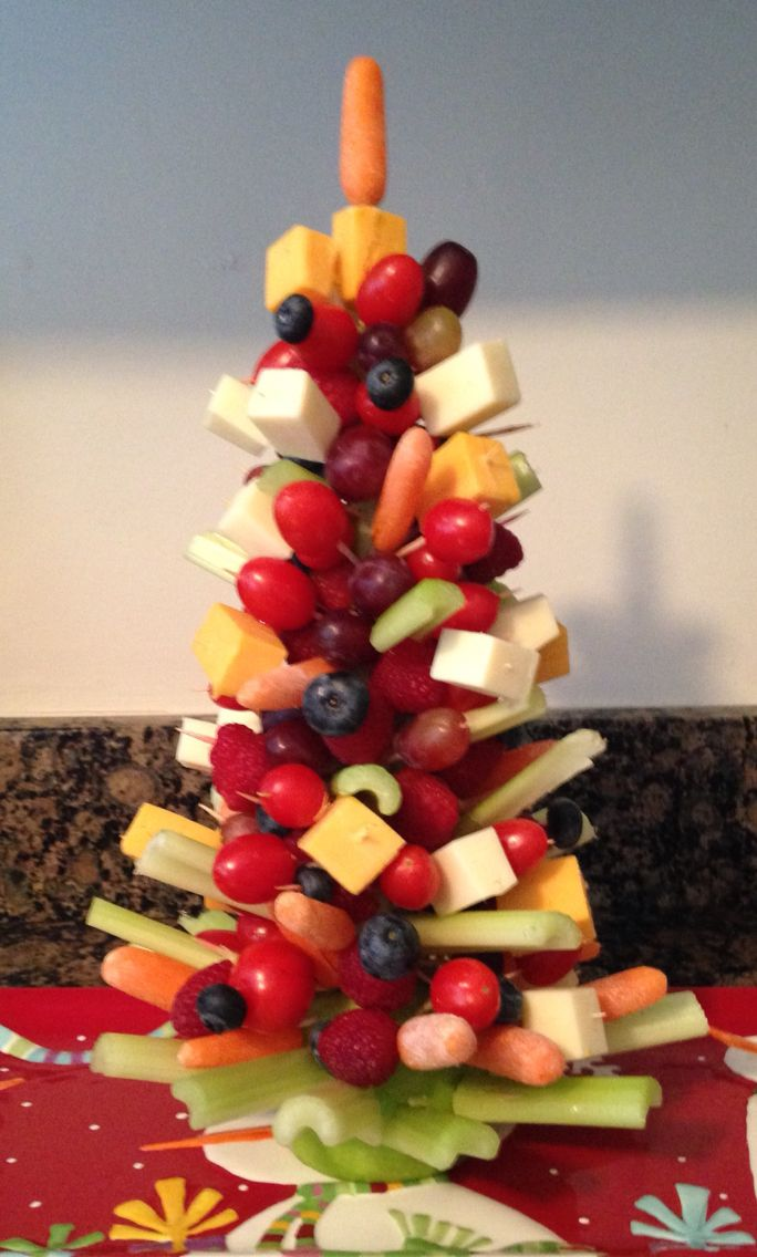 Appetizer Christmas Tree placed on celery sticks and and 1/2 apple with toothpicks of fruits, veggies and cheese.