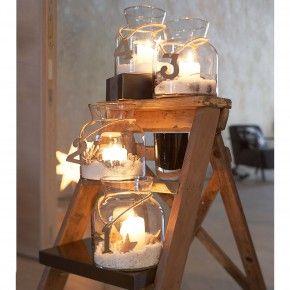 Kaarsen voor de adventstijd: kijk bij www.old-basics.nl voor grote glazen vasen, flessen en apothekerspotten