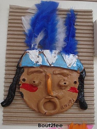 indianengezicht van klei