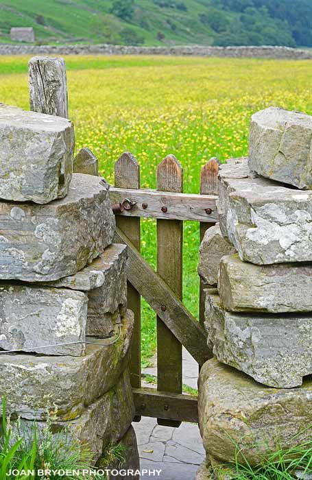 A gated stile leading into a hay meadow at Muker in Swaledale