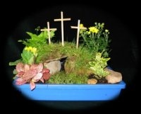Easter gardens are sometimes made by children to show the empty tomb. These can be made by using pebbles or rocks to build a miniature tomb, a stone to make the rock that was rolled away from the entrance, small pieces of cloth to represent the grave clothes and lots of small spring flowers to make a garden around the tomb.