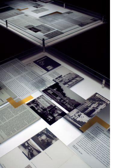 Plexi and metal exhibit labels - layer photos, articles, catalog pages, cutouts, etc. with plexiglass labels or clear captions over them