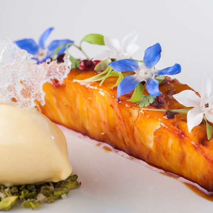This sweet and sticky recipe by Simon Hulstone sees pineapple transformed into a luxurious, caramel-infused dessert. The chef adds texture to the dish with a tropical sorbet served atop crushed pistachios.