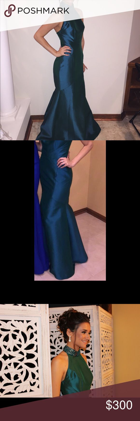 Neiman Marcus emerald green dress Beautiful gown metallic emerald green dress, worn once before, in perfect condition was bought at a size 2 and was altered to a size 0 to fit me. Has an open back. I am 5'5'' was on sale from $995 and bought it for $650 Neiman Marcus Dresses Prom