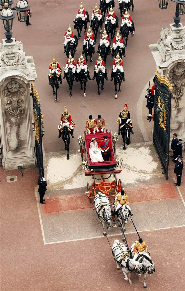Prince William and Princess Catherine approach Buckingham Palace by carriage procession following their marriage at Westminster Abbey.