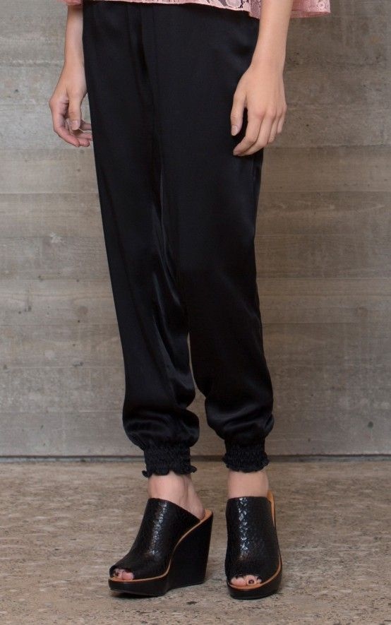 Elastic waist solid silk pant with elastic at the leg cuffs. Slant pockets at the front. Patch pocket at the back. Relaxed fit. #rachelcomey