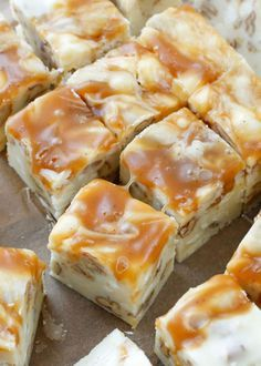Creamy white chocolate fudge filled with pecans and swirled with caramel might be the ultimate treat for a holiday tray. White Chocolate Caramel Pecan Fudge is a quick and easy 5 Minute Fudge Recipe and it's a huge favorite this year.