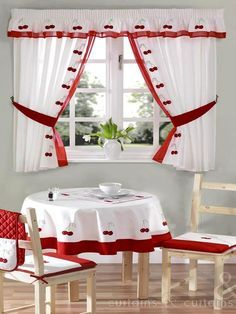 Cherry kitchen curtain is embroidered delicately, and is finished with a red voile trim. Free matching tie backs are also included in this range.