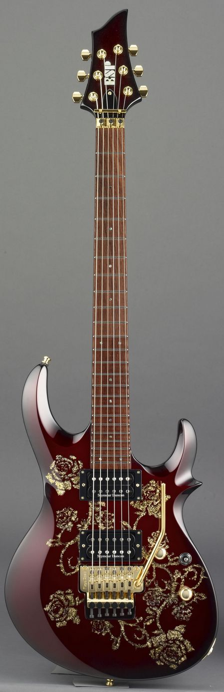 ESP Sakura mahogany finish guitar - RESEARCH gorgeous stringed musical instrument with embedded design for roses, branches swirling around the body. -