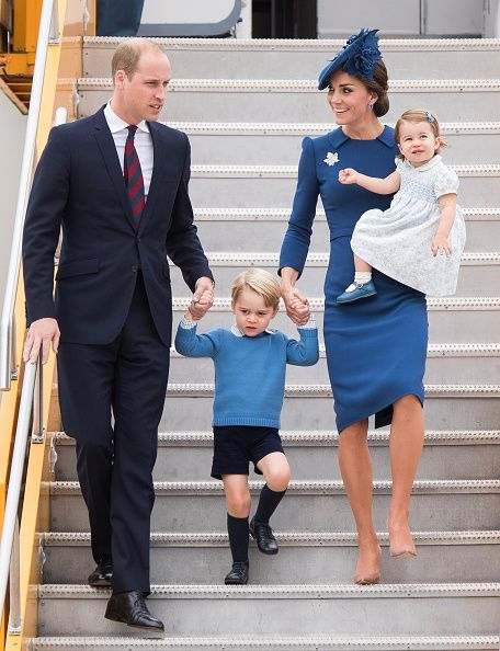 Catherine, Duchess of Cambridge was wearing a blue Jenny Packham dress and held her daughter Princess Charlotte with Prince George and her husband Prince William, Duke of Cambridge as they walked down the steps from the plane